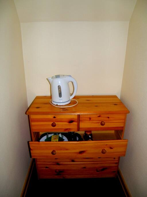 every room has electric kettle, cups, plates, coffee, tea, sugar.