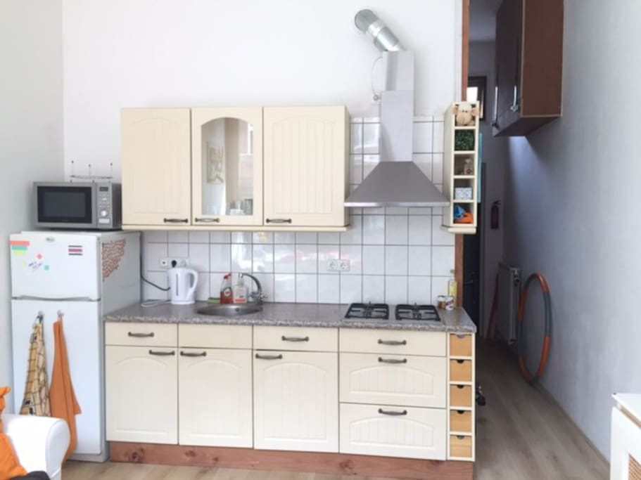 Kitchen with microwave/oven, fridge and freezer.