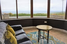 Our Sunroom with amazing views across the bay