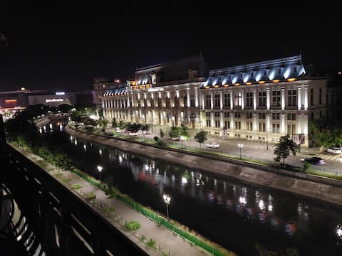 """""""Moonlight River""""Studio is your city oasis accomodation in the heart of the Old City Center of Bucharest.This cosy studio is newly furbished and enjoys a great view over the Palace of Parliament and the River in front of the Old City Center."""