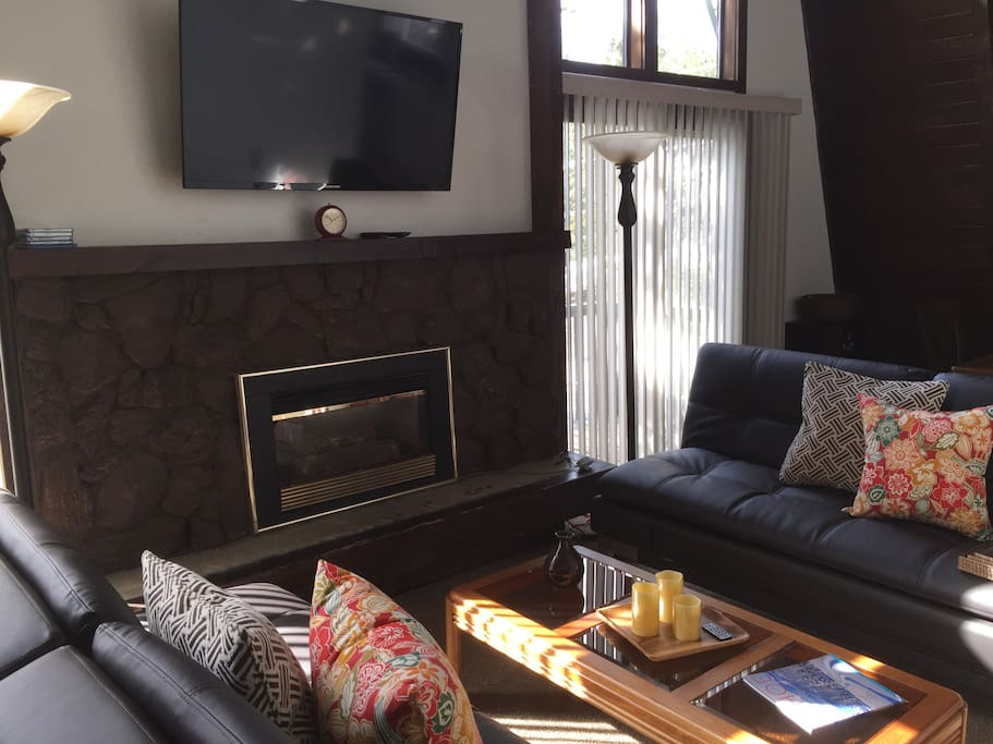 Fireplace with TV above and sitting area in Great Room