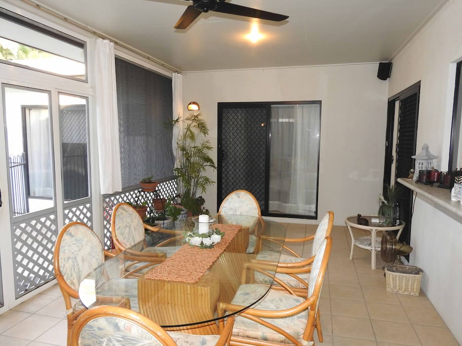 Casual dining in our fully enclosed patio overlooking the pool