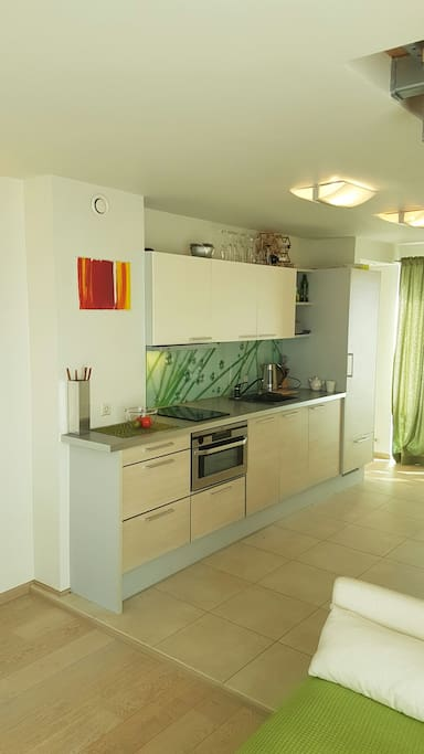 Fully equipped kitchen with dishwasher, oven and washing machine.