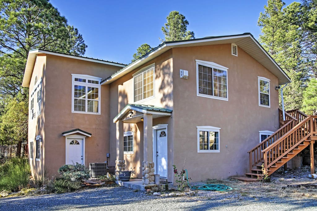 This 4-bedroom, 2-bathroom vacation rental cabin will immerse you in New Mexico charm!