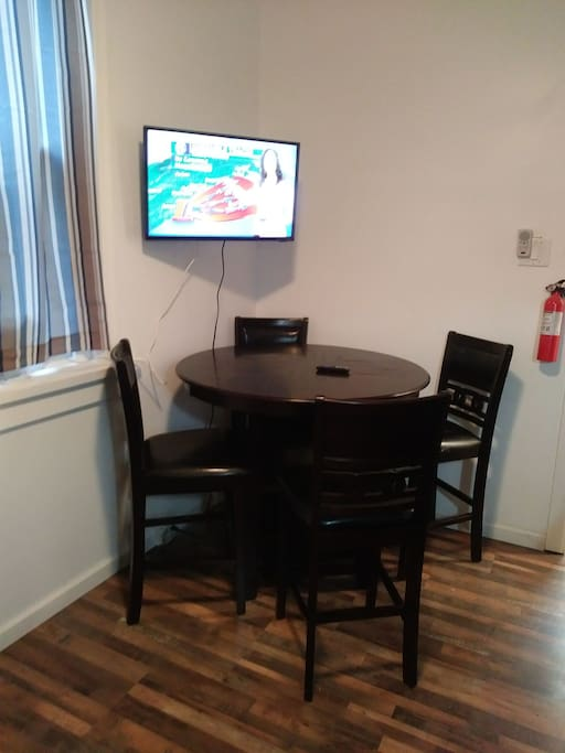 bar top table for television in eat in kitchen that is shared with one other room