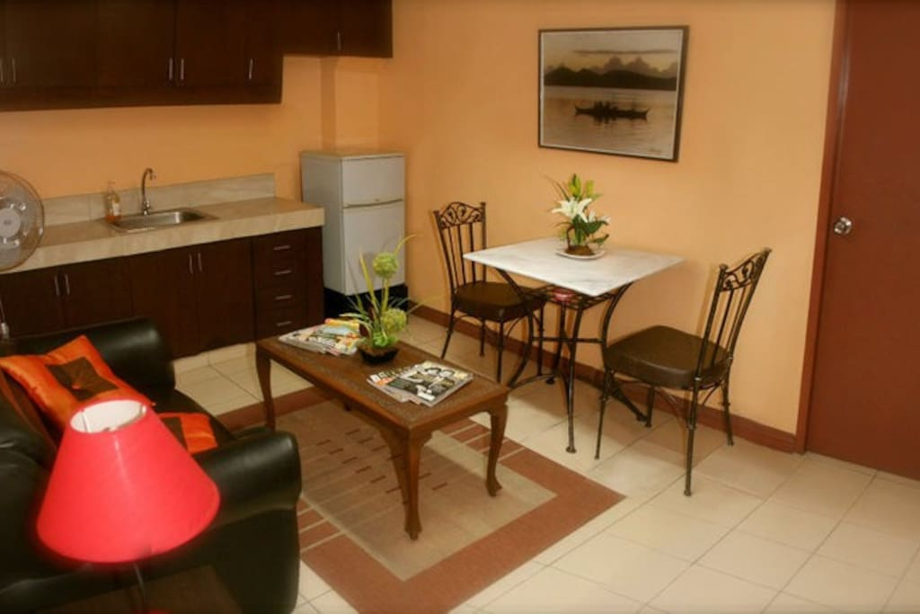 This is the dining room and living room. The kitchenette has everything you need to make and enjoy a delicious home-cooked meal.