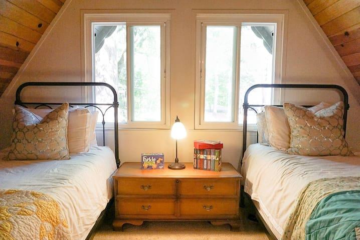 Pretty little A-Frame sleeping loft.
