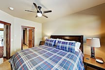 Sleep soundly in the master bedroom, furnished with a king-size bed.