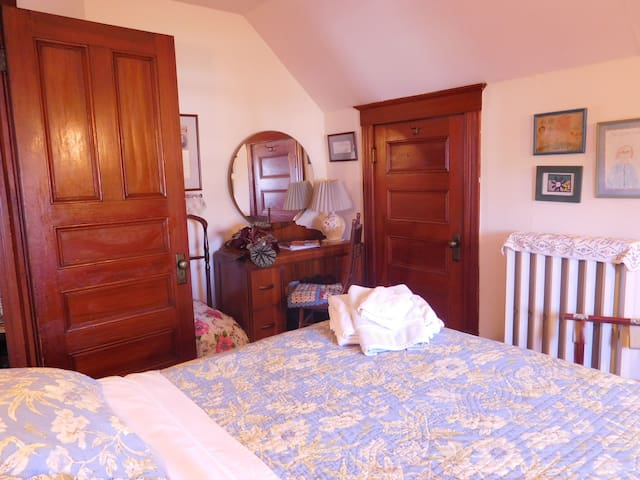 Your bedroom with queen bed and attached bathroom