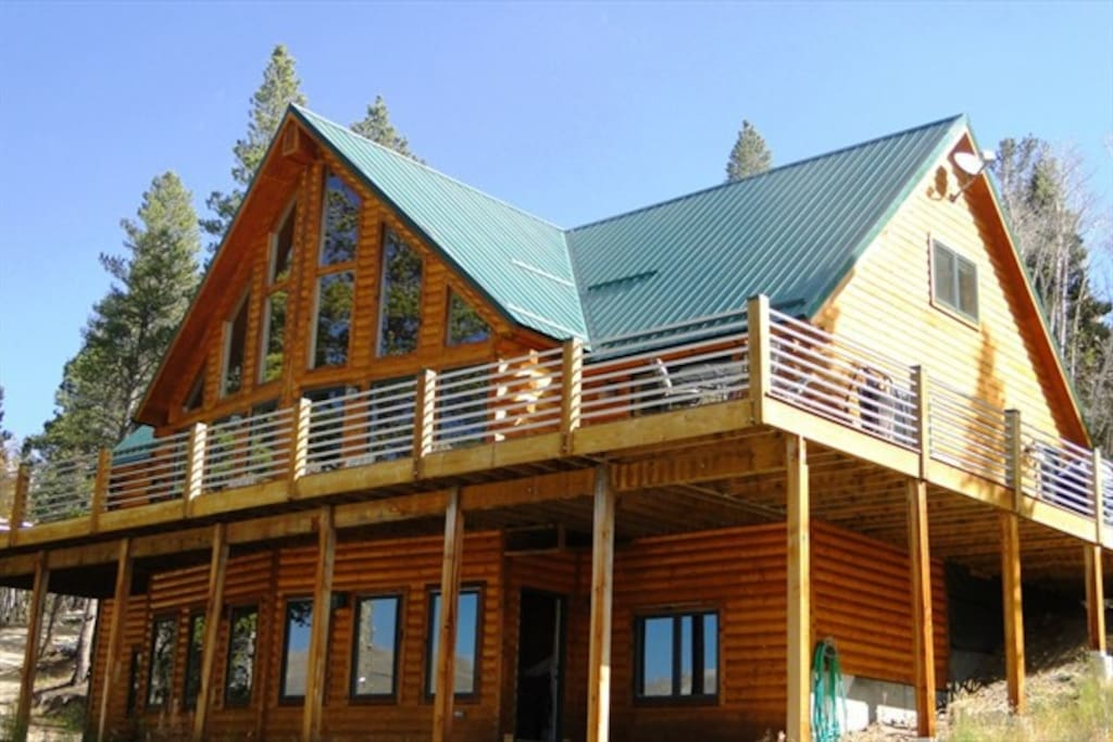 """The Timbers"" at Glacier Ridge is a magnificent vacation home with 4 fullbaths, 2 half baths, two living areas, a billiards room, hot tub, fire pit and views of the Continental Divide!"