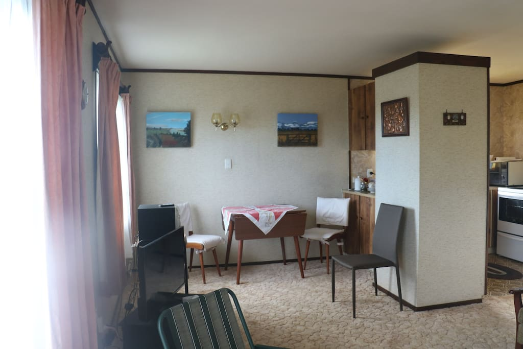 Dinning area with extra chairs.TV plus DVD Player.