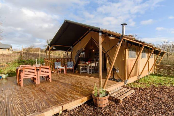 Luxury safari tent with wood burning stove