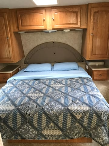 Queen bed w/2 closets and storage above and below bed