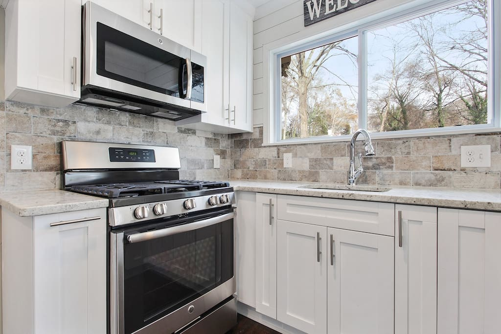 Newly renovated in 2018, this kitchen is just as shiny in person!