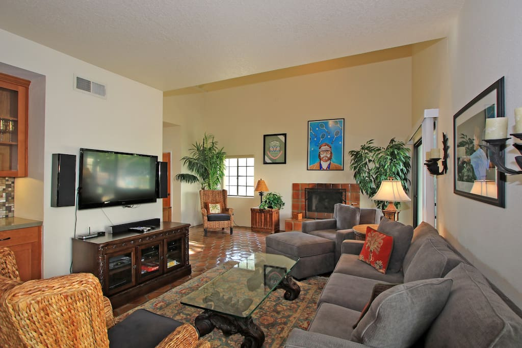 Couch, flat screen TV and wet bar