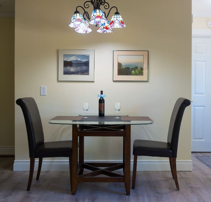 The dining area.  We provide a bottle of red wine--if you don't like wine, let us know and we won't put it out.  Two more chairs are stored in the office.