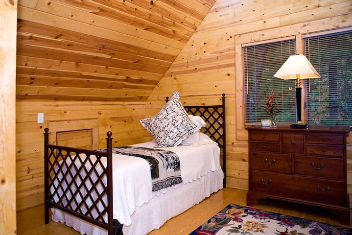 The twin bed loft is above the living room and has a half bath