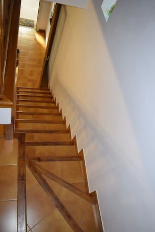 Looking down the stairwell to the front door.  Note that the stairs are steep and narrow, and have a minimal handrail.