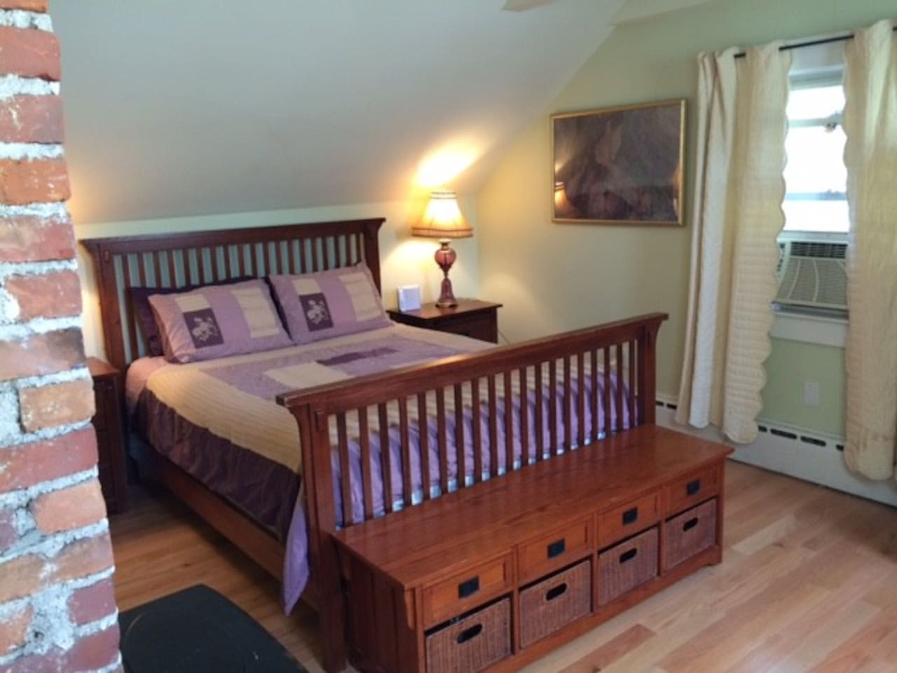 Queen size bed and a window air conditioner