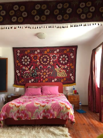main bedroom with antique Turkish wall hangings