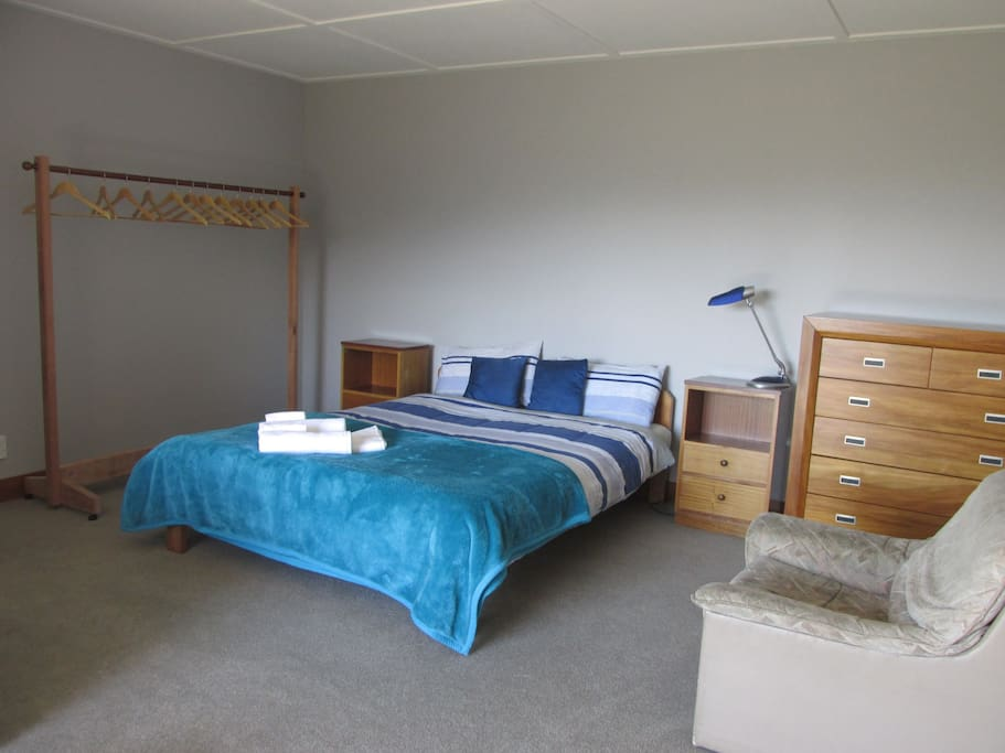 spacious guest room with double bed, in winter with electric blanket.