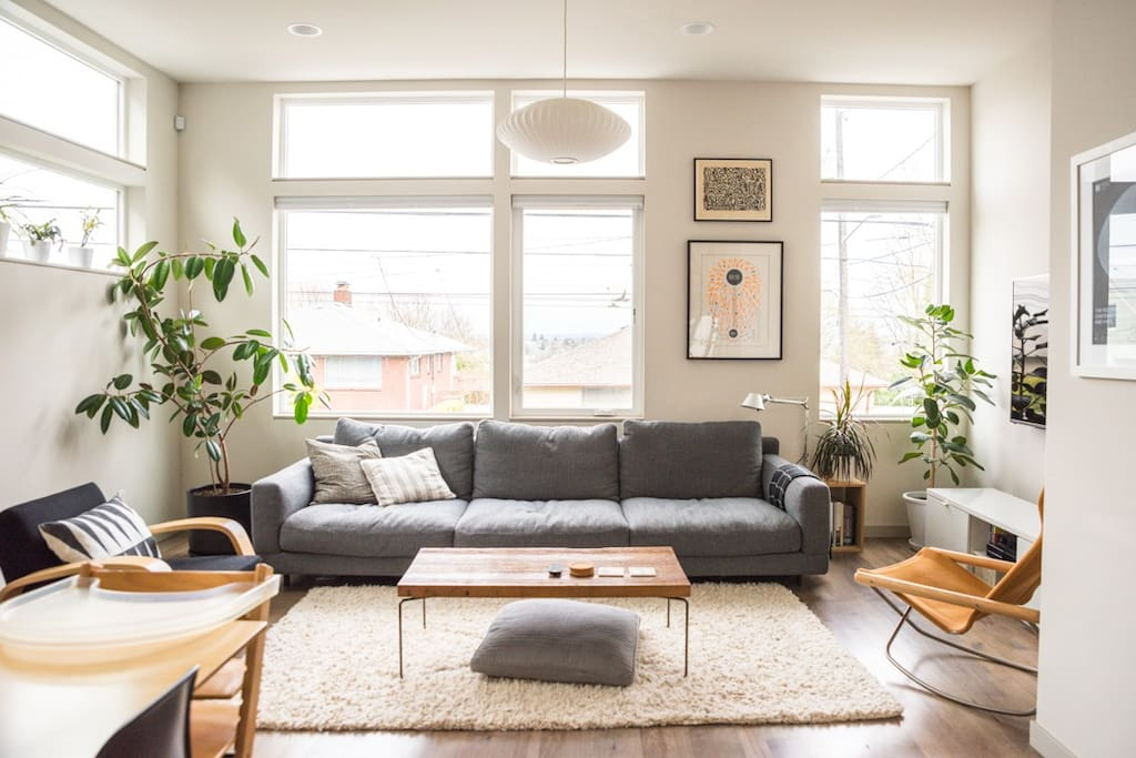 The main level with open floor plan with living room, dining room, kitchen, and powder room. It's a perfect chill out spot for fellow design enthusiasts and plant lovers.