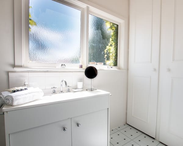 Upstairs en-suite with plenty of room and natural light