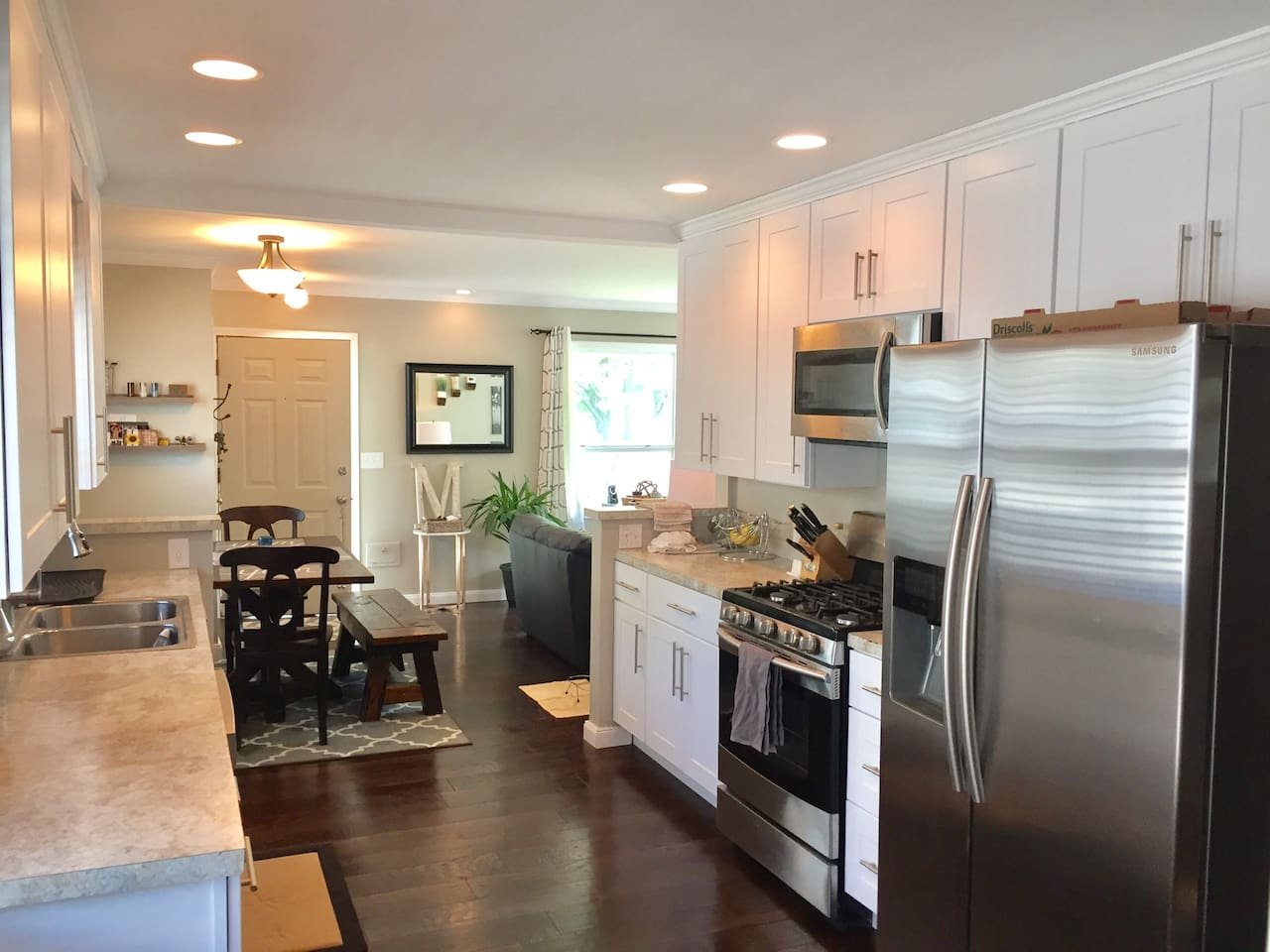 Newly remodeled single family home with a large galley kitchen, spacious living room, dark hardwood floors, brand new stainless steel appliances, brand new cabinets & hardware, hand crafted table and matching bench set.  Plenty of space for the whole family!