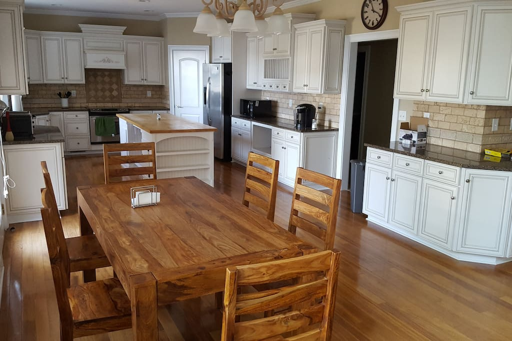 Large kitchen with island and table for six
