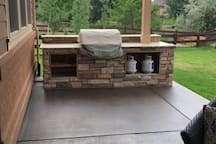 Gas grill with granite, stone and piped in gas!