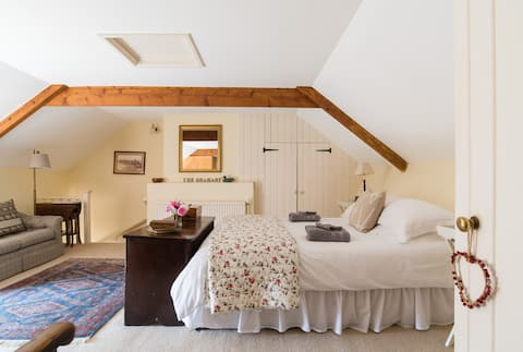 Comfortable large ensuite bedroom in old farmhouse