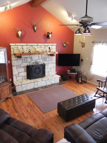 "Vaulted ceilings in family room. Oversized reclining couch and chair. Storage ottoman. Vintage rocker. 50"" flat screen TV. Satellite TV with lots of stations including wide selection of music stations of all genres."
