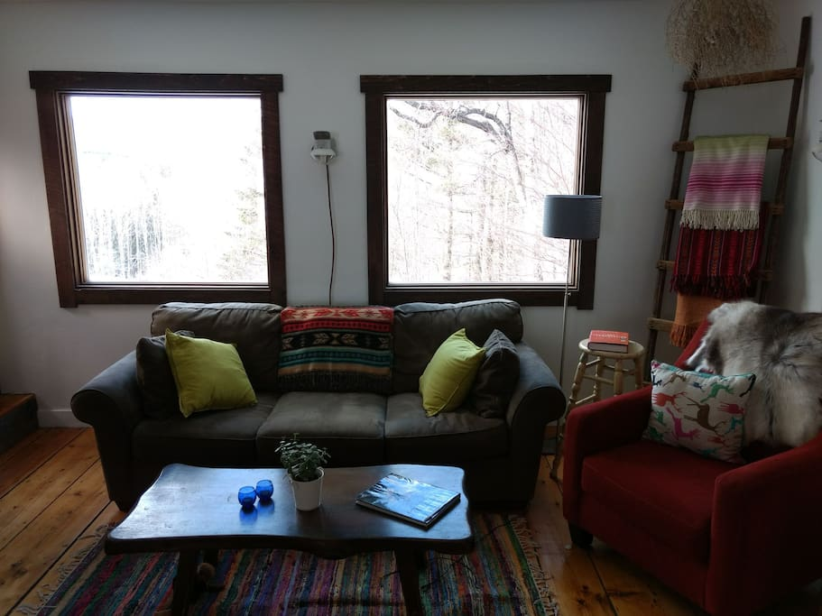 Living room with new large windows out towards big views.