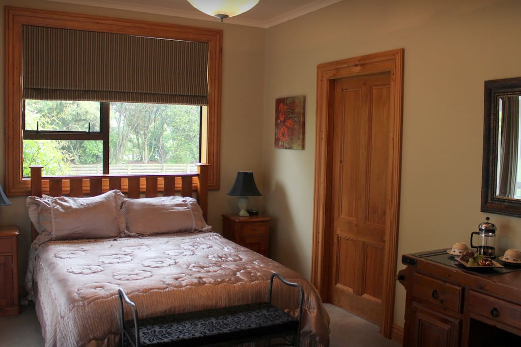 One of our two rooms with comfortable bed, tea & coffee making, crockery & cutlery, TV, fridge...