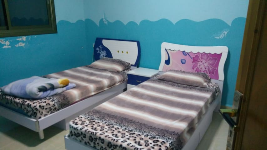Private bedroom with twin beds