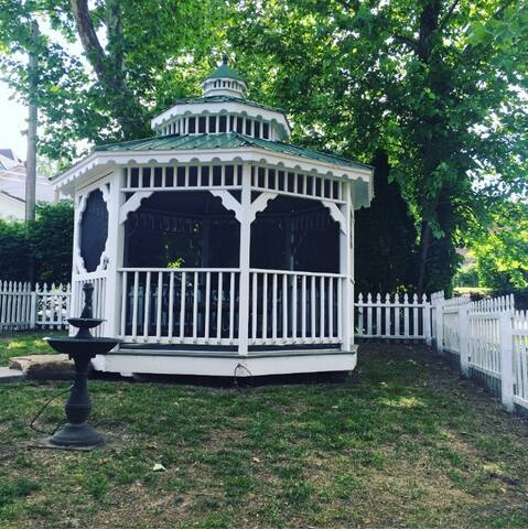 Private fenced yard with gazebo