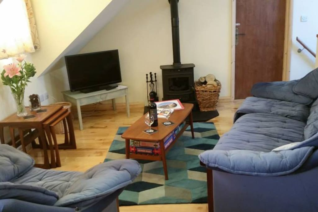 The first floor open plan lounge, with Villager wood burner