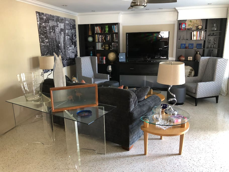 """Open living room with 55"""" Flatscreen and a queen size Laz-Y Boy sleeper sofa"""