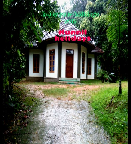 """it is located on top of a hill. It is called """"kunnil holidays"""". """"KUNNIL""""  in malayalam language means hill. It is a traditional style house with full wooden sealings."""