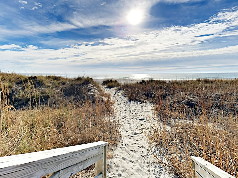 Follow a sandy dune line to the beachfront -- just steps from your door.