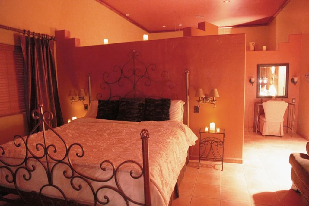 king size bedroom with sofa and Amoire ; large Mexican Amoire Televison, Stereo, Wifi