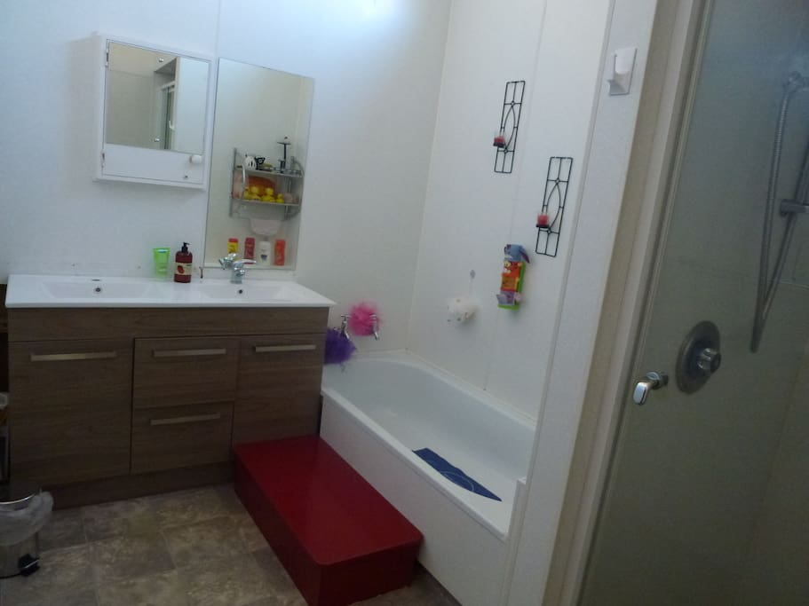 Guest bathroom with bath, separate shower and twin hand basin vanity.