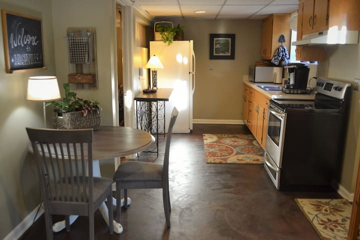 Full kitchen and dining nook, lit with soft, indirect natural light