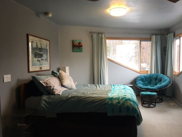Queen size bed with new mattress and chair to look at the Mountain View