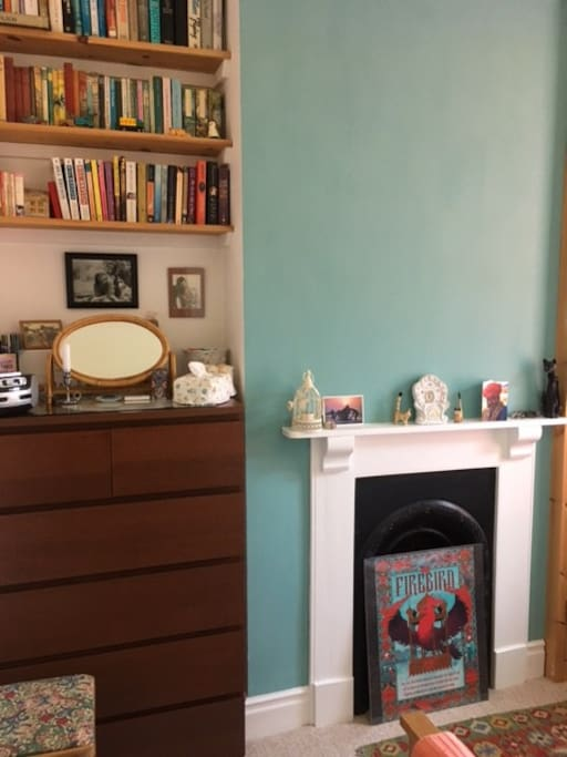 Newly decorated guest room with radio, hairdryer and plenty of books.