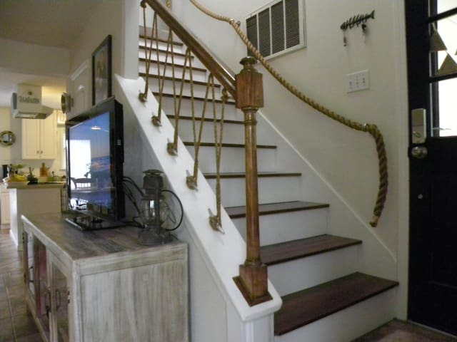 The room is at the top of the stairs