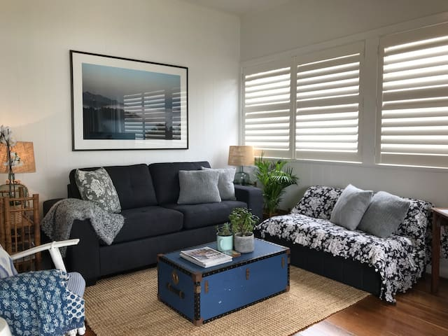 Sofabed with inner spring mattress in sitting area