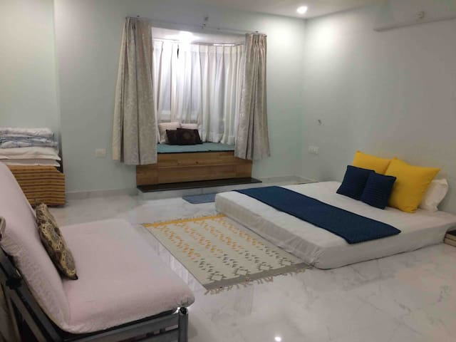 Master bedroom with king size floor mattress and sofa which can be turned into queen size bed and also a bay window overlooking the lush green park