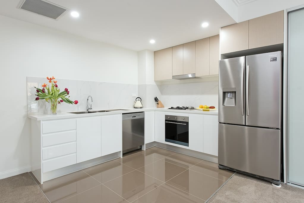Feeling hungry? Enjoy the open plan kitchen with brand new appliances.