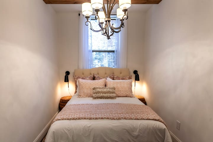 Bed and chandelier